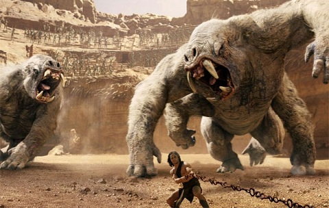 John Carter (Taylor Kitsch) taking on a pair of white apes.